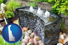 delaware map icon and bubbling water feature in a landscape