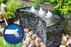 massachusetts map icon and bubbling water feature in a landscape