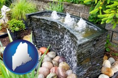 maine map icon and bubbling water feature in a landscape