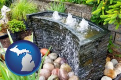 michigan map icon and bubbling water feature in a landscape