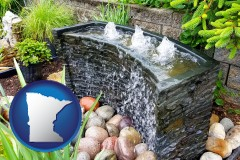 minnesota map icon and bubbling water feature in a landscape