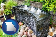missouri map icon and bubbling water feature in a landscape
