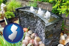new-jersey map icon and bubbling water feature in a landscape