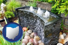 ohio map icon and bubbling water feature in a landscape