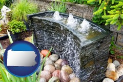 pennsylvania map icon and bubbling water feature in a landscape