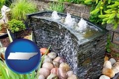tennessee map icon and bubbling water feature in a landscape
