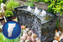 vermont map icon and bubbling water feature in a landscape