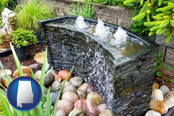 bubbling water feature in a landscape - with Alabama icon