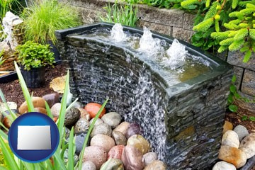 bubbling water feature in a landscape - with Colorado icon