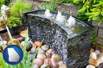 bubbling water feature in a landscape - with Georgia icon
