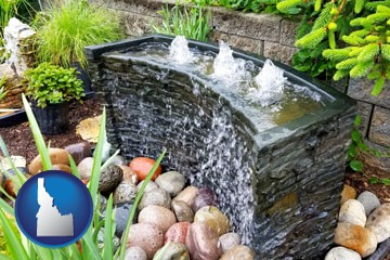 bubbling water feature in a landscape - with Idaho icon
