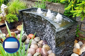 bubbling water feature in a landscape - with Kansas icon