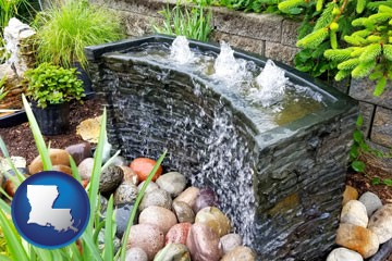 bubbling water feature in a landscape - with Louisiana icon