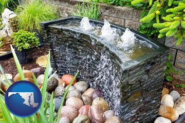 bubbling water feature in a landscape - with Maryland icon