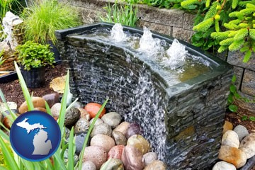 bubbling water feature in a landscape - with Michigan icon