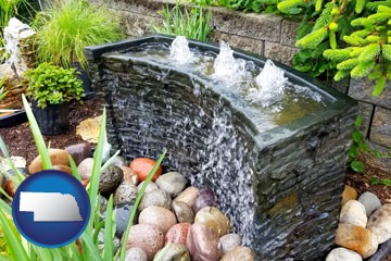 bubbling water feature in a landscape - with Nebraska icon