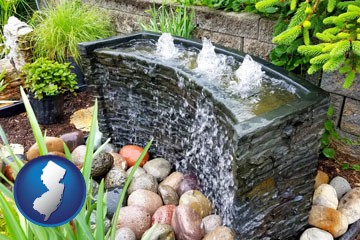 bubbling water feature in a landscape - with New Jersey icon
