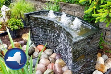 bubbling water feature in a landscape - with New York icon