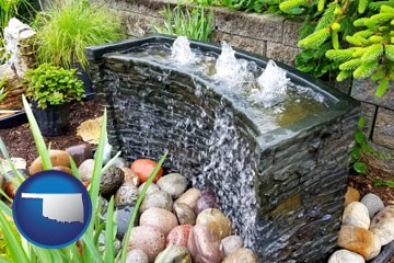 bubbling water feature in a landscape - with Oklahoma icon