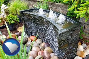 bubbling water feature in a landscape - with South Carolina icon
